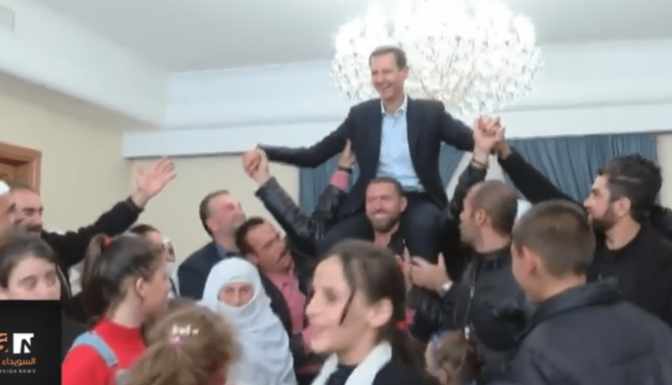 Freed Suweida hostages raise Syria's Assad onto their shoulders